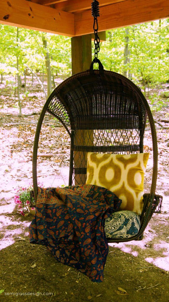Swinging chair under treehouse