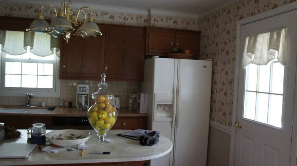 kitchen before covered in fruit wallpaper