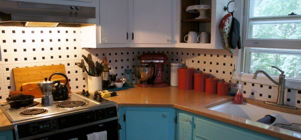 kitchen with aqua cabinets and black and white tile backsplash
