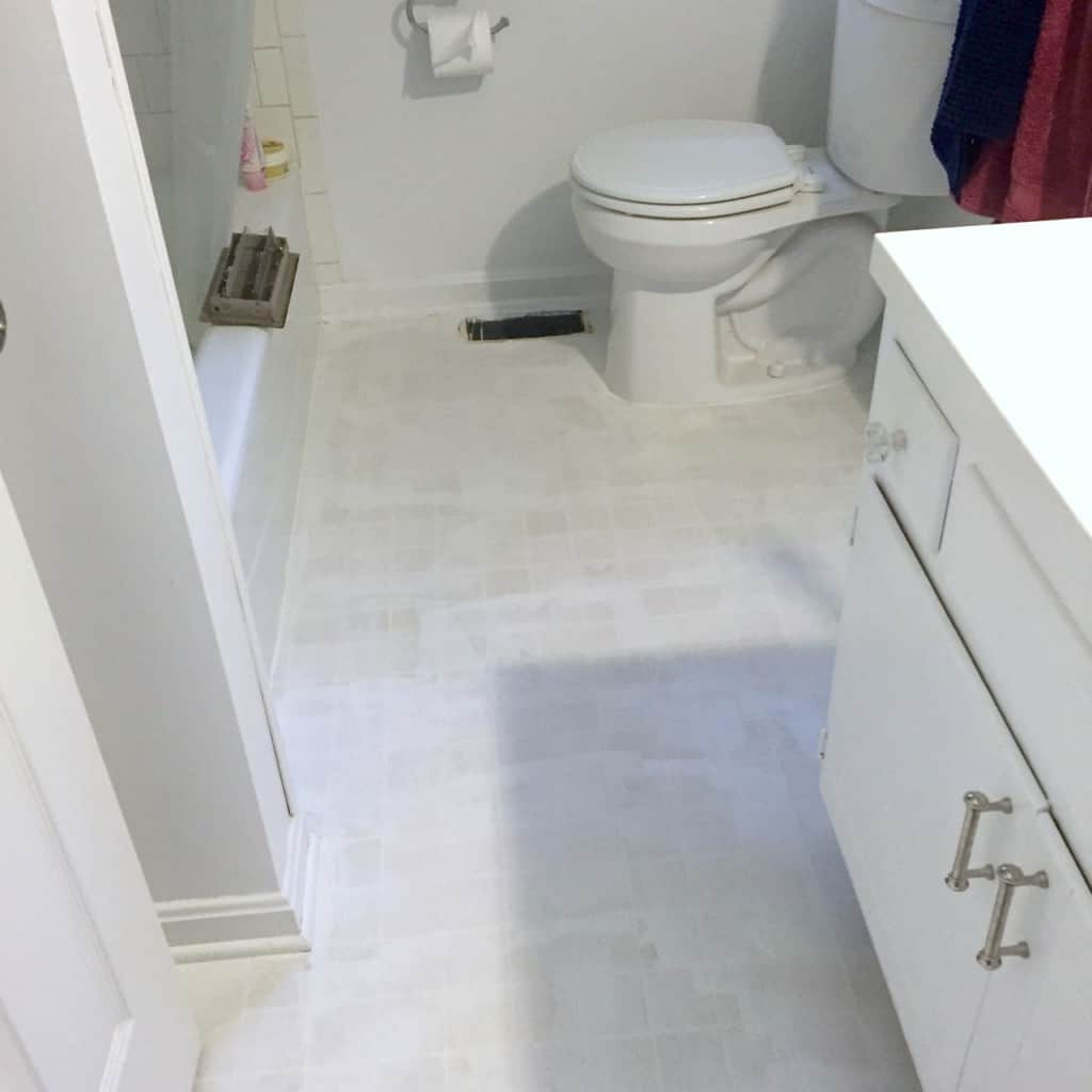 Stenciled floor you can paint your ugly vinyl tile for Can you paint vinyl tile