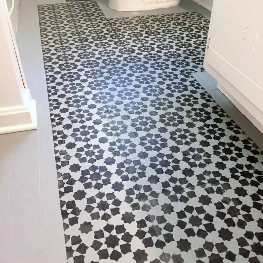 Stenciled floor you can paint your ugly vinyl tile for Painting vinyl floor tile