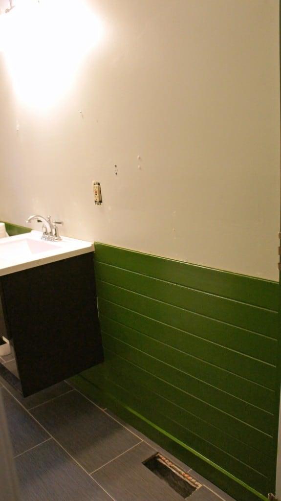 installing tile floor in a bathroom