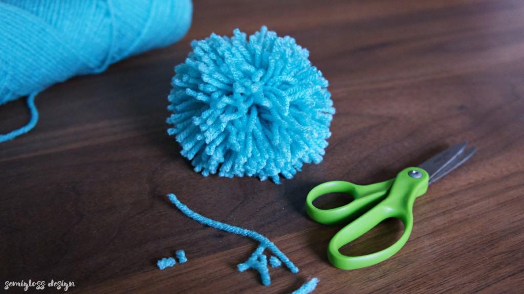 Trim excess yarn