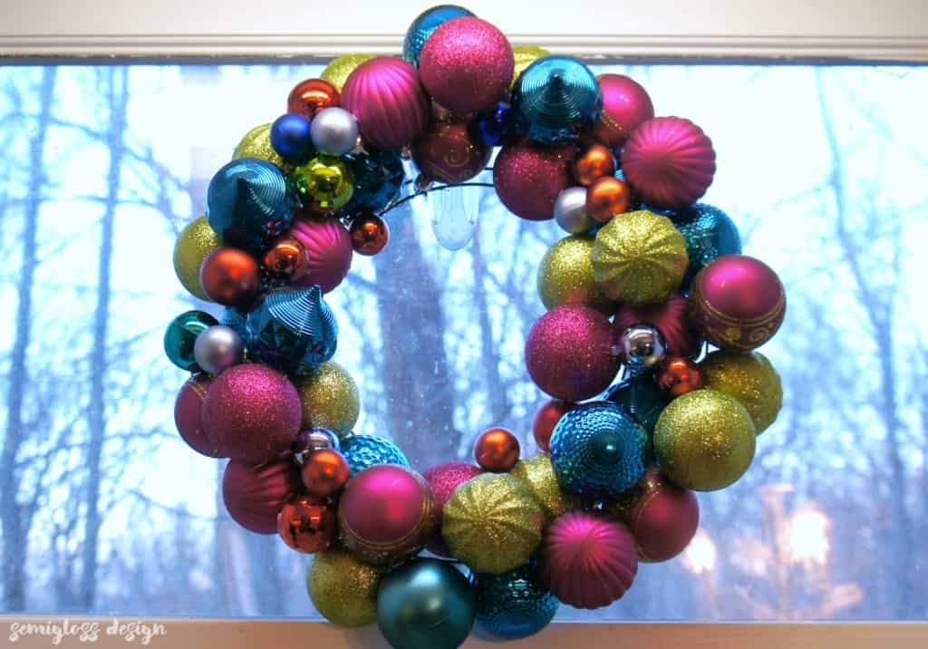 A DIY ornament wreath is a fun way to add color to your holiday decor. Make one today! #christmasdecor #christmasdecorations #christmaswreaths #ornamentwreath