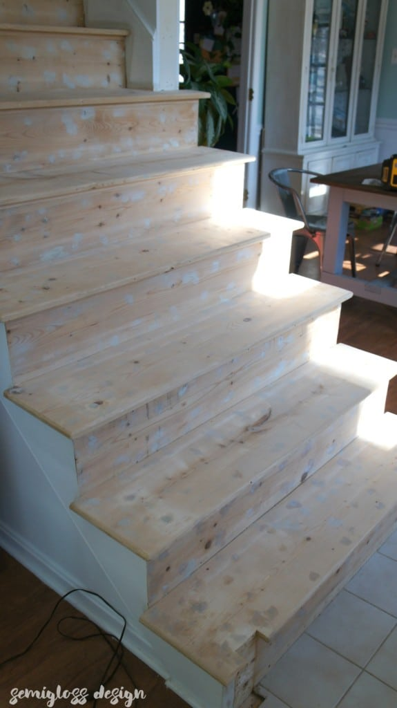 filled staple holes and baluster holes to get stairs ready for stain