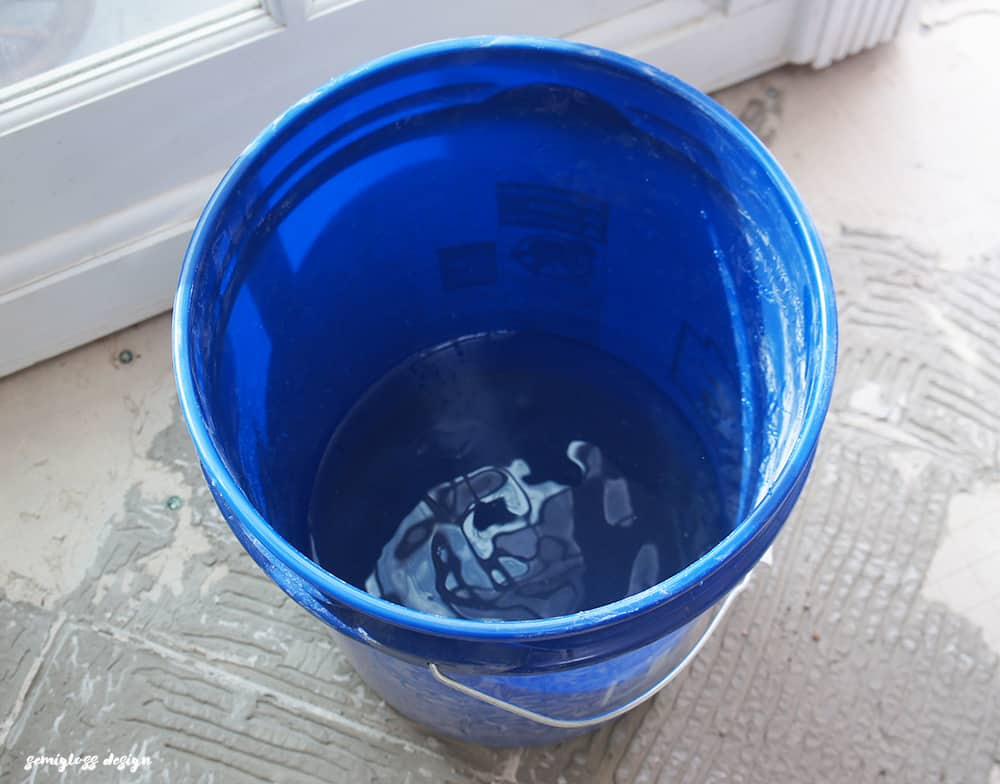 water in bucket to mix concrete