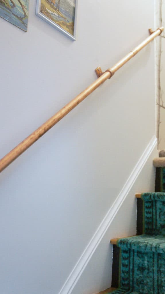 copper pipe in stairway