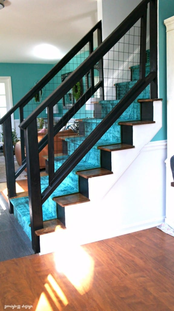 modern staircase makeover with metal grid fencing