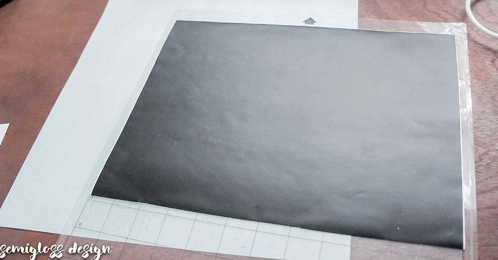Place vinyl on mat