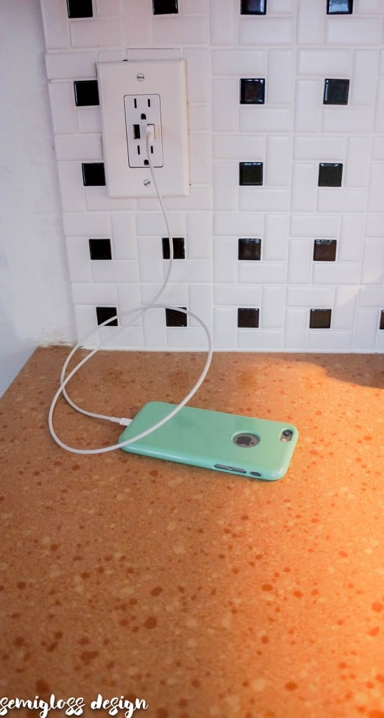installed USB outlet charging a phone