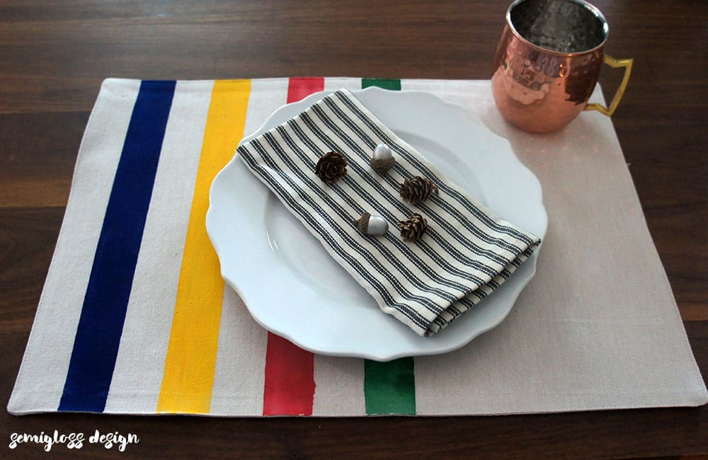 Make your own camp blanket inspired placemats for your fall table. These DIY placemats are easy and quick to make.