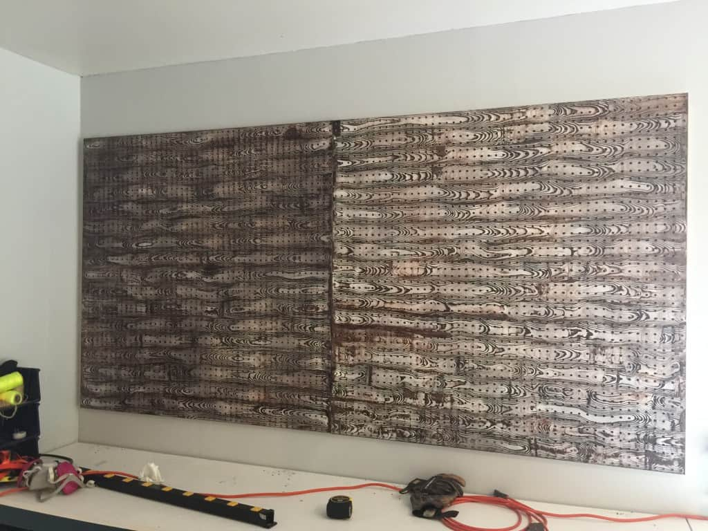 installed pegboards on wall