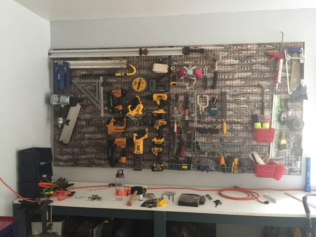 wood grain pegboard installed in garage with tools