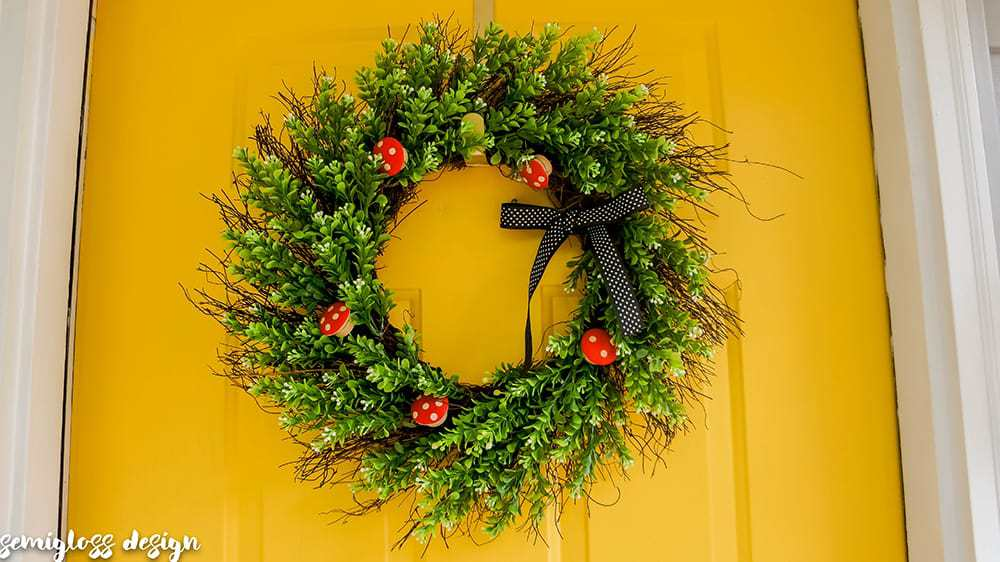 This DIY wreath ideas is as adorable as it is easy to make! Add a woodland touch to your door with this cute mushroom wreath.