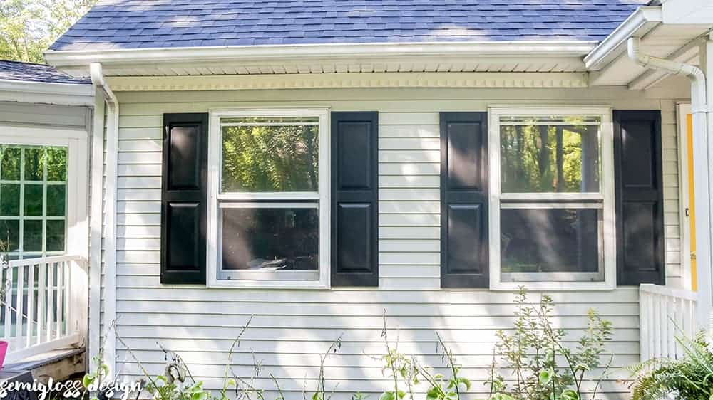 Updated painted vinyl shutters on light gray siding