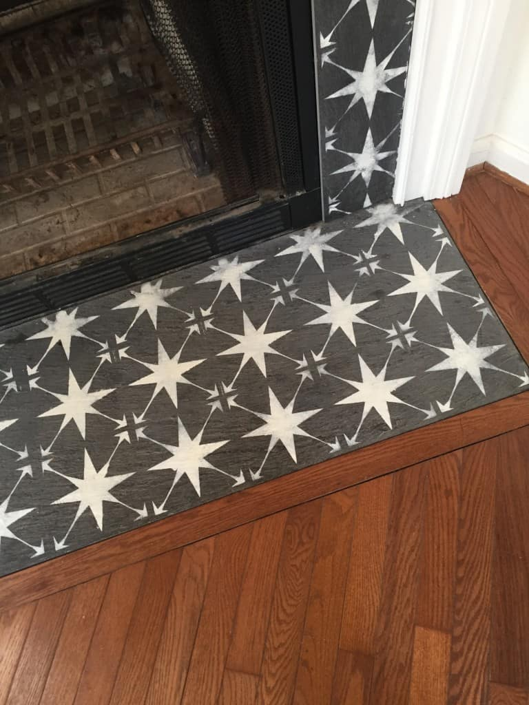 Stenciled fireplace tile surround