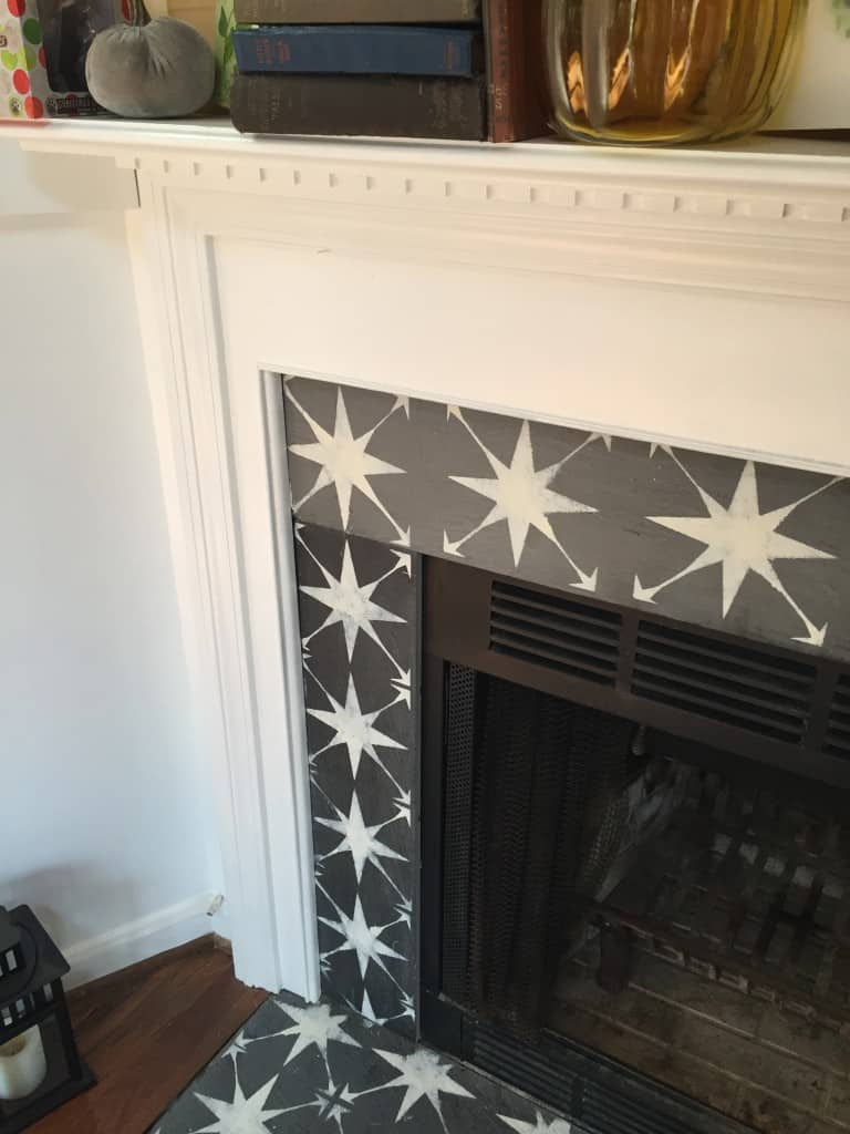 Learn how to paint fireplace tile using a stencil to instantly update your fireplace. This easy fireplace makeover is so easy to do!