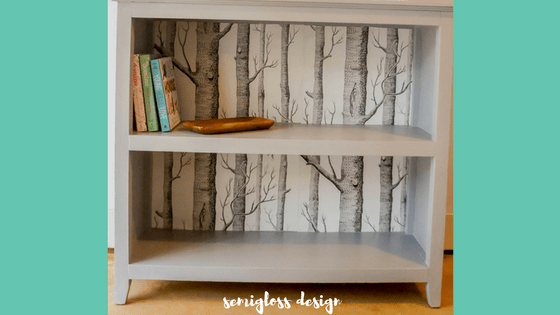 A bookshelf makeover with paint and leftover wallpaper. Make that boring bookshelf amazing!