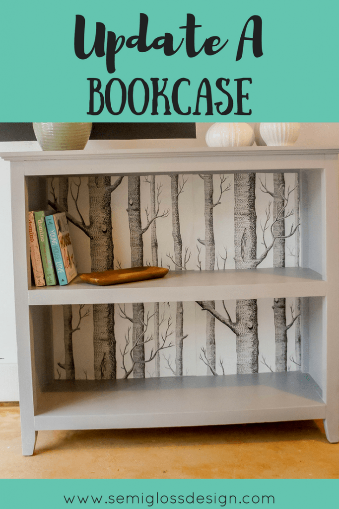 Bookcase makeover with tree wallpaper