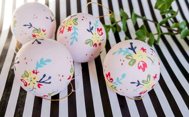Make your own floral hand painted Christmas ornaments. Don't worry if you're not an artist. This method relies on the brush to do the work and makes you look good!