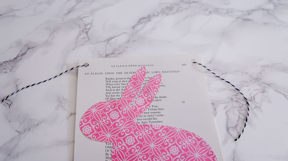 Need an easy spring project? This DIY Easter banner is made with scrapbook paper and old book pages. It's an easy craft to bring in some spring color. #eastercrafts #easterbunny #cutfiles #papercrafting