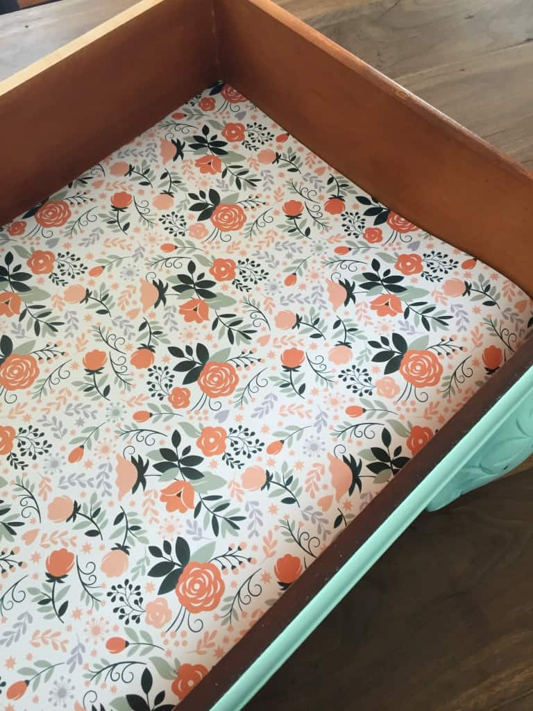 How to add DIY drawer liners to your furniture makeovers using wrapping paper. #furnituremakeover #paintedfurniture #prettypaper
