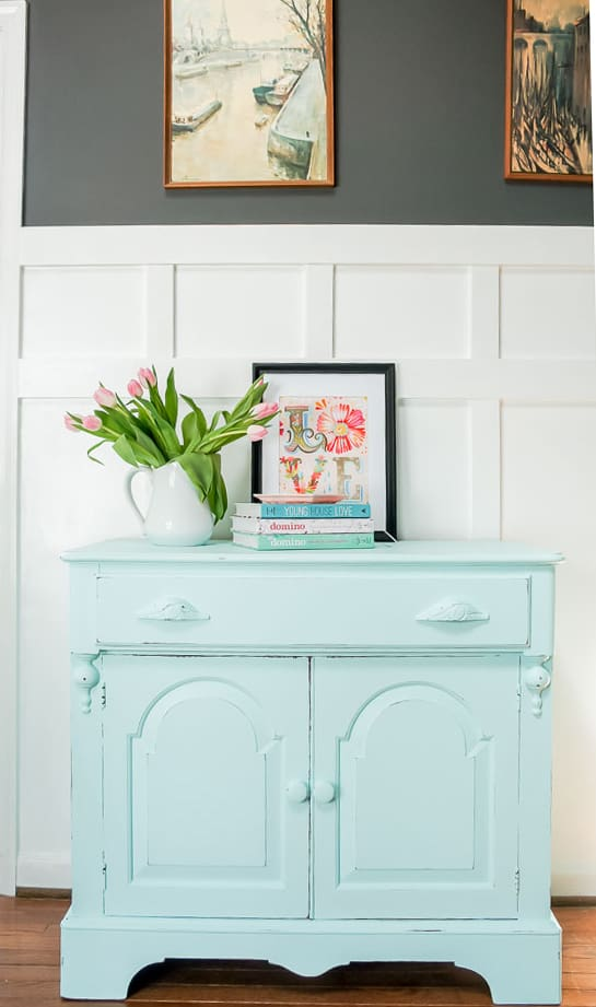 A spring furniture makeover featuring a pastel aqua paint on a credenza. This piece went from stuffy to gorgeous! #painted furniture #fusionmineralpaint #springdecor