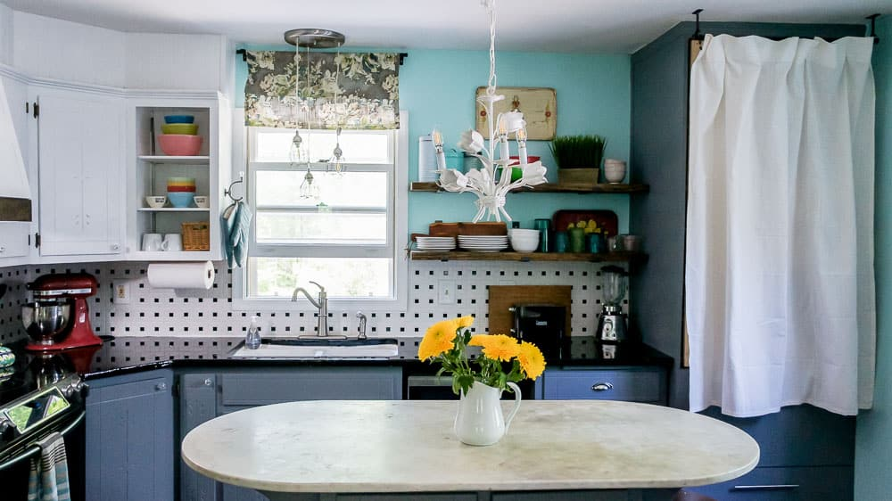 This colorful kitchen makeover on a budget is heavy on DIY and light on the wallet. A few simple changes go a long way in updating an old kitchen.