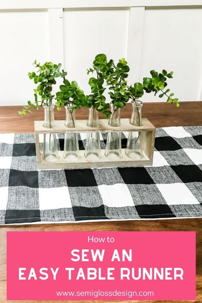 "pin image - black and white table runner on wood table with text overlay ""How to Sew an Easy Table Runner"""