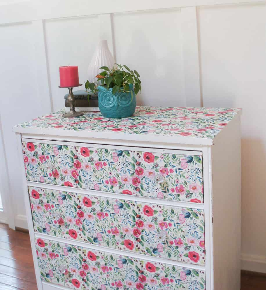 Learn how to decoupage on wood furniture. This step by step tutorial walks you through using napkins to add pattern to a dresser to create a floral decoupaged dresser.