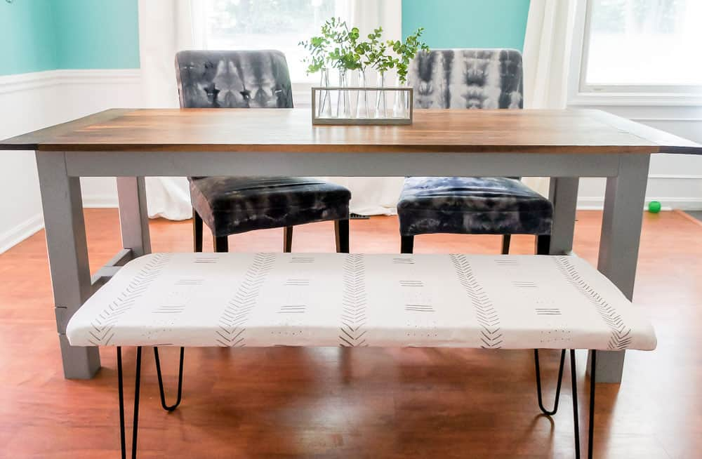 Learn how to make an easy DIY bench. Ever wish you had extra seating? This versatile DIY bench is the perfect solution for adding extra seating for guests!