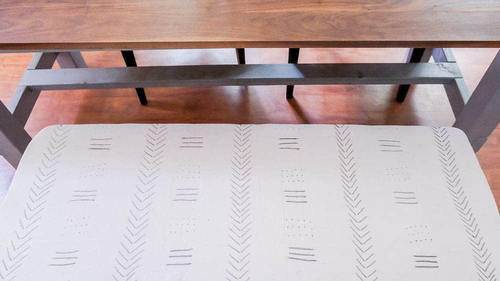 Learn how to make your own DIY mud cloth from drop cloths. This easy DIY is inexpensive and easy to do, even if you're not artistic!