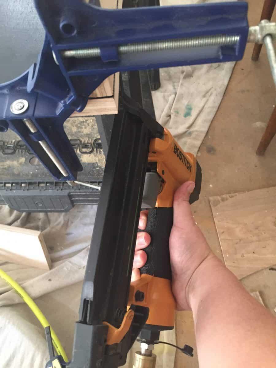 Use nail gun to attach wood
