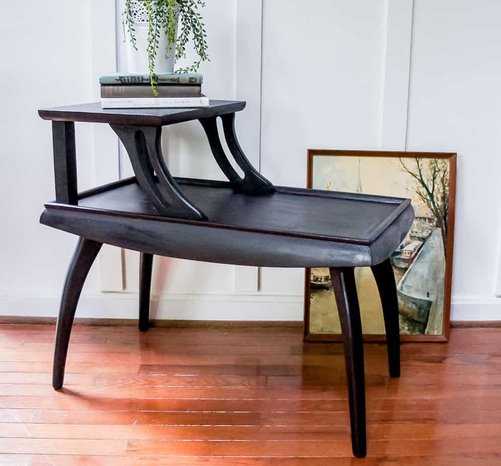 These mid century side tables had a dated finish, but that's easy to fix with paint! Check out this mid century side table makeover painted in a gorgeous black!