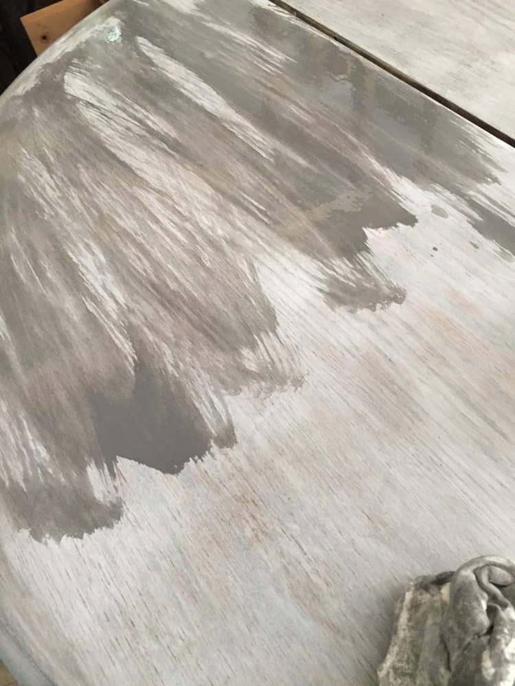 Gray coat of stain over whitewash