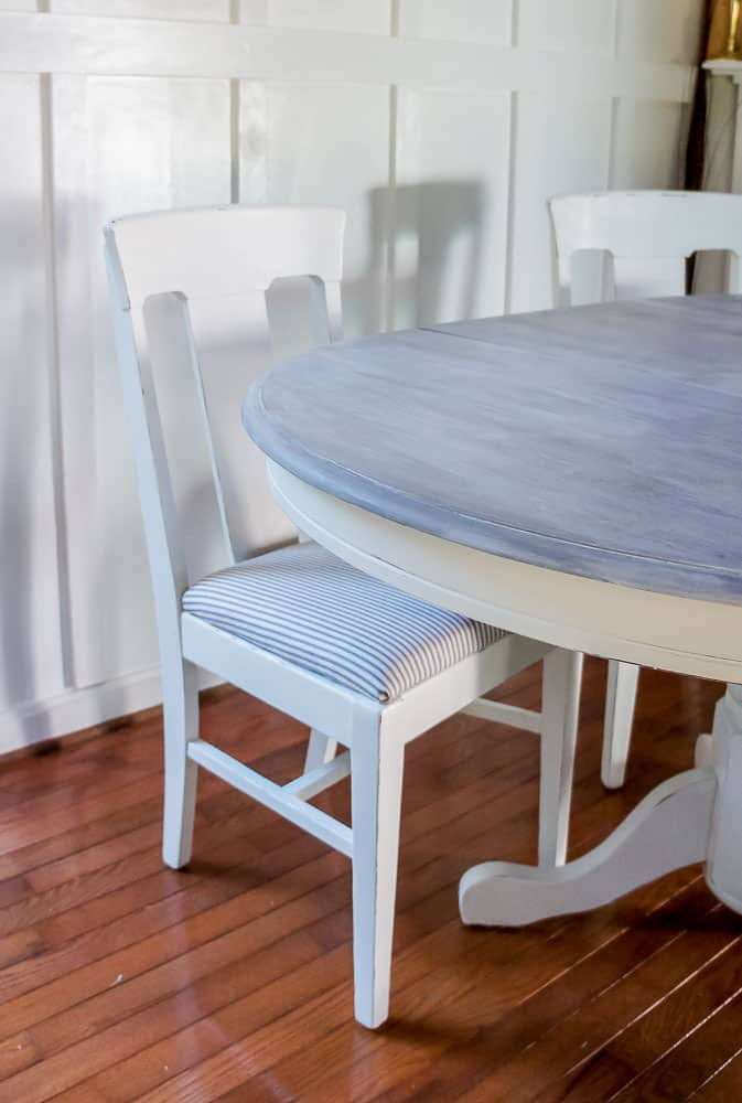 Weathered wood stain pedestal tables and chairs