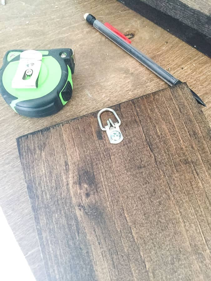 Attach D ring hanger to sign