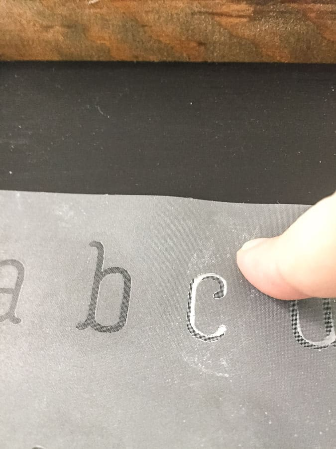 Use stenciled letters to align stencil