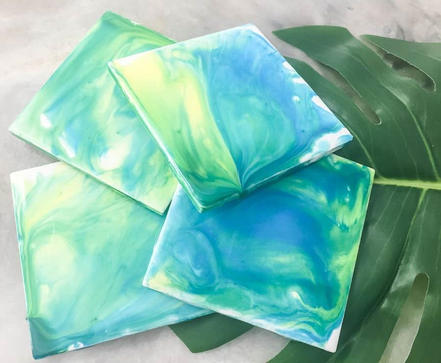 paint pour coasters on tropical leaf