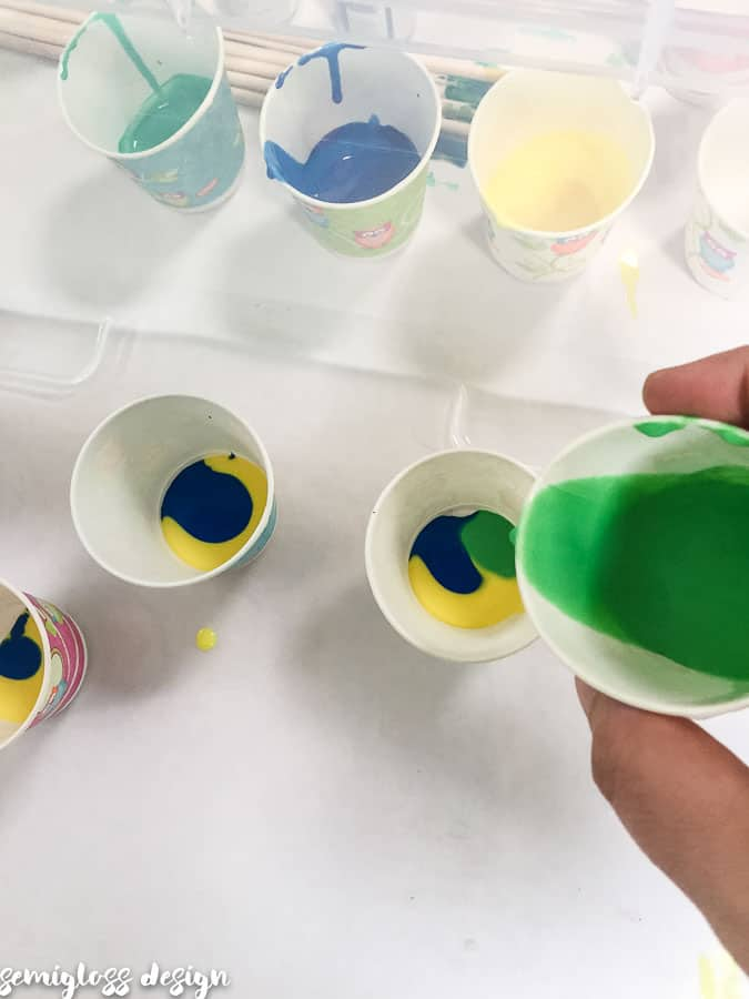pour paint slowly into cups