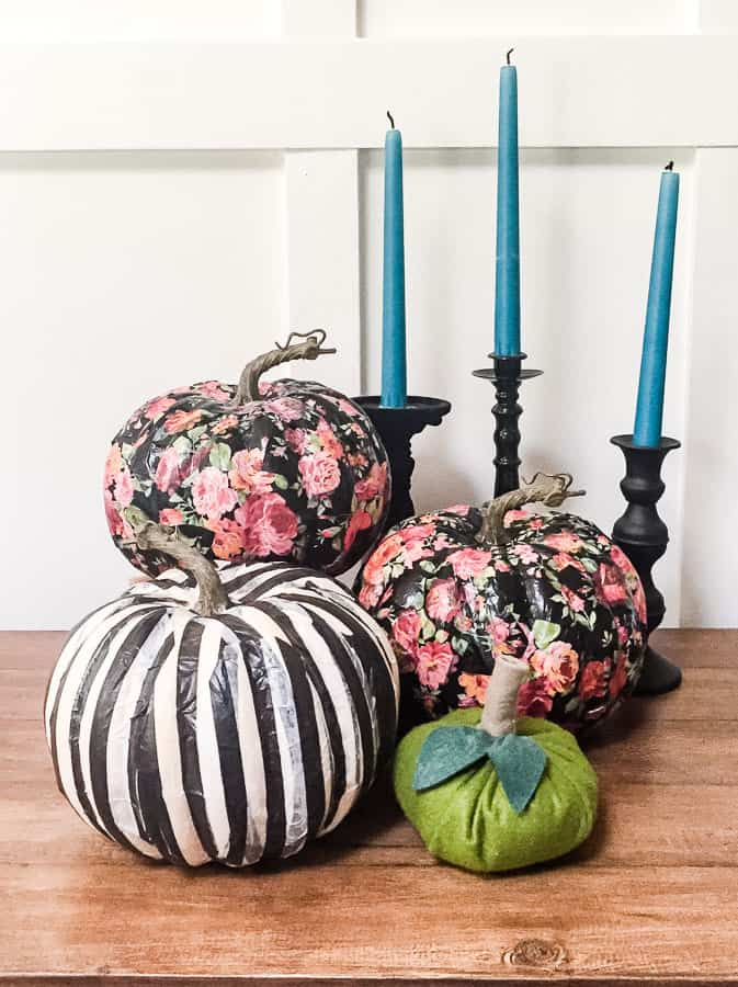 Floral and striped pumpkins made with tissue paper decoupage