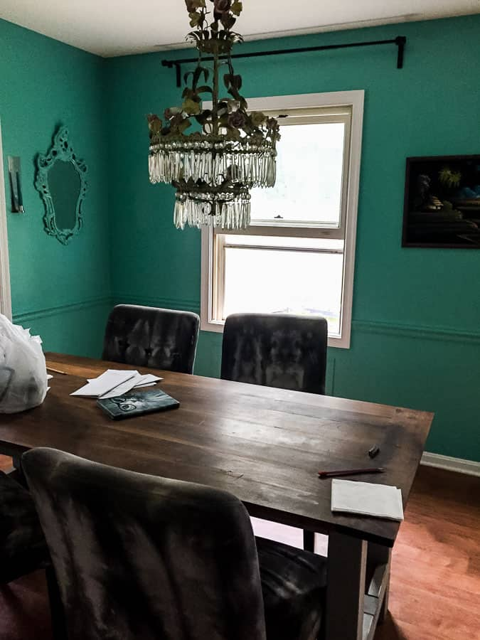 teal painted walls in dining room