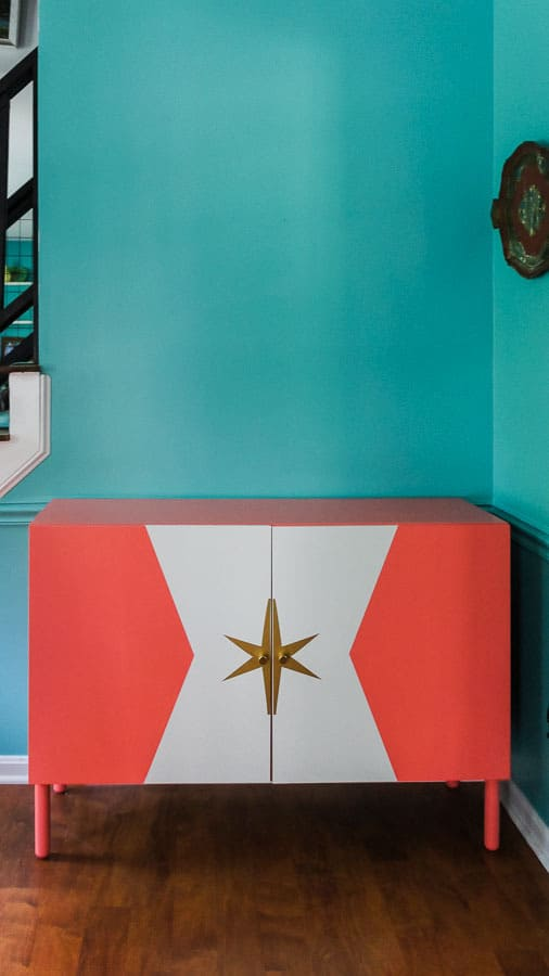 coral ikea besta against turquoise wall