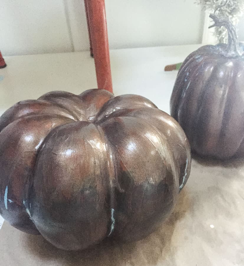 painting pumpkins with bronze paint