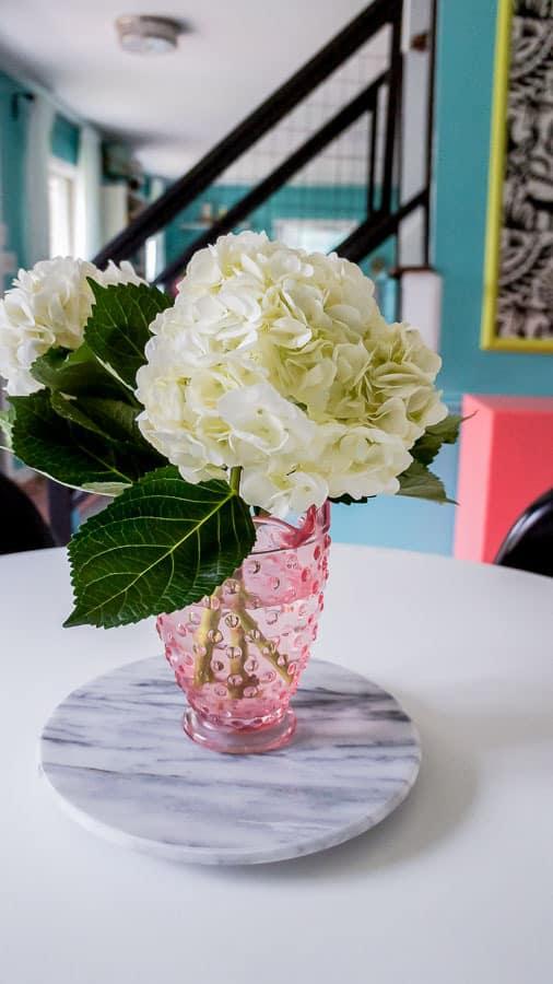 hydrangeas in pink vase