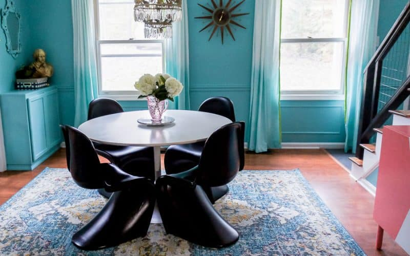 dining room with teal walls
