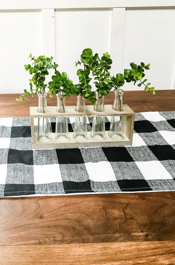 Finished buffalo check table runner with vases