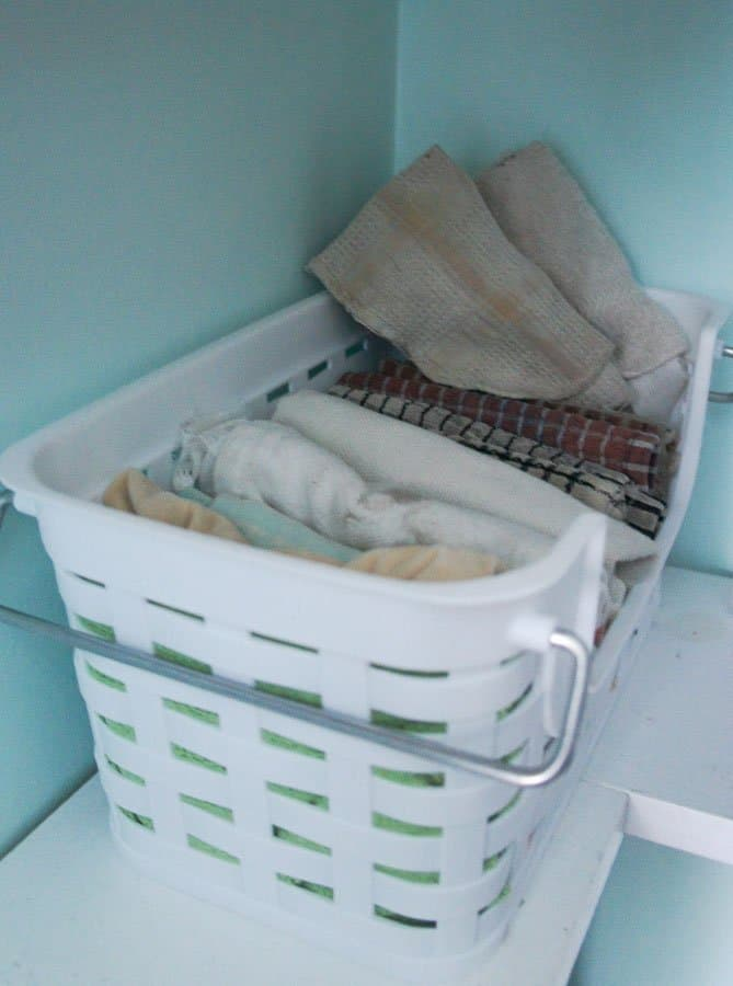 plastic basket with cleaning rags
