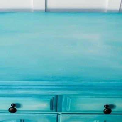layered chalk paint on aqua buffet cabinet