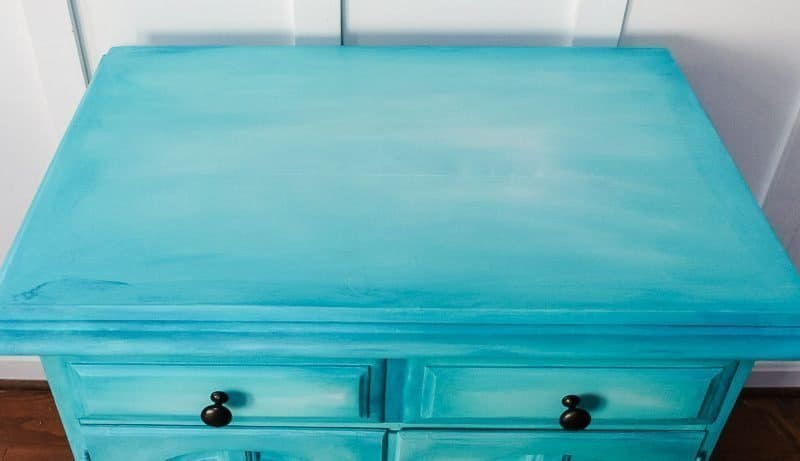 layered chalk paint on aqua buffet cabinet